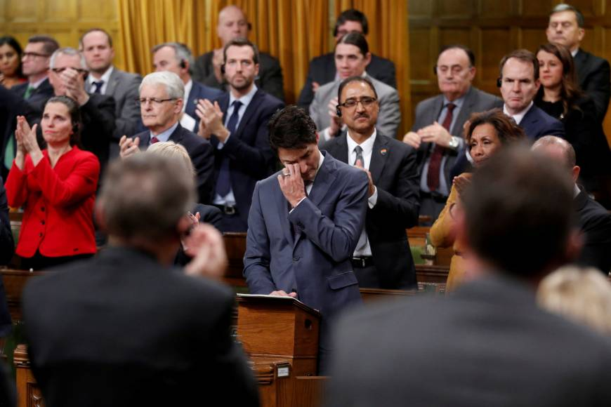 Justin Trudeau wipes away tears as he apologises for Canada's historic persecution of gay people