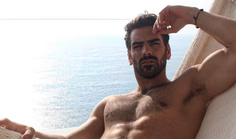 Nyle DiMarco goes wild for completely naked mountaintop photo